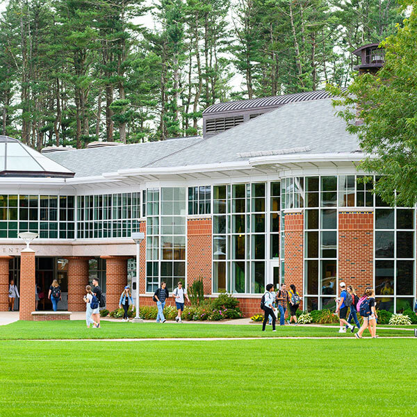 Students walk down the pathways of the Mount Carmel Campus quad outside of the student center