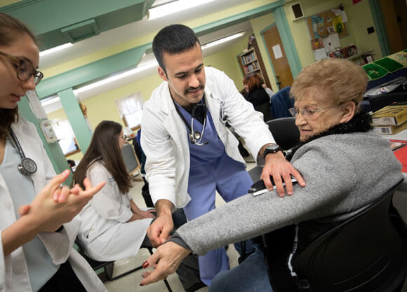 Physician assistant students volunteer with community members during a health fair