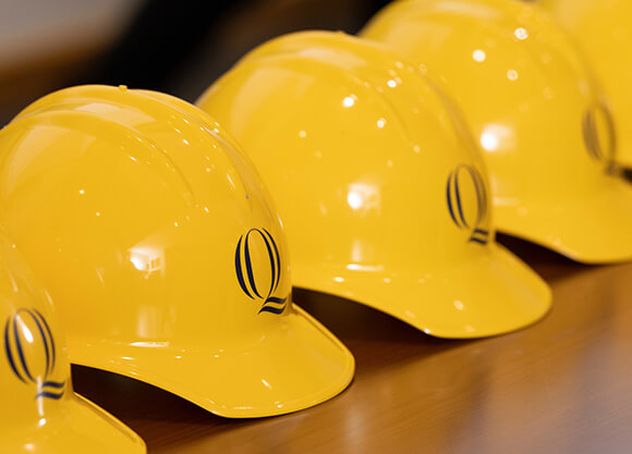 Gold hard hats in a row
