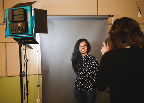 Student getting headshot taken for Linkedin