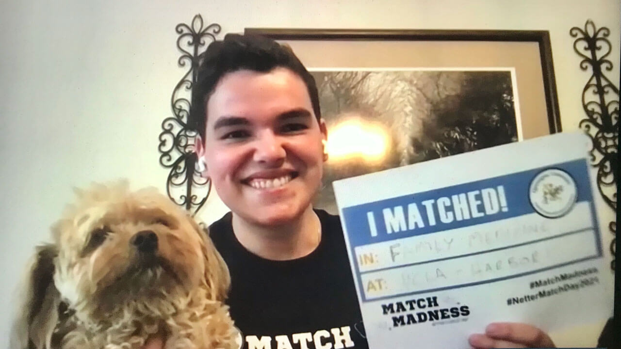 Richard Ferrous celebrates his residency match with his dog