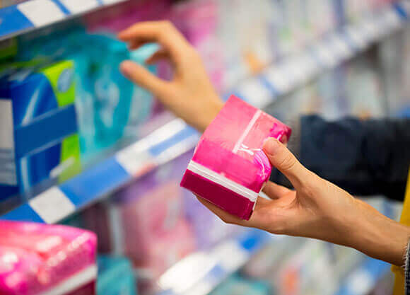 Woman reaching for feminine products