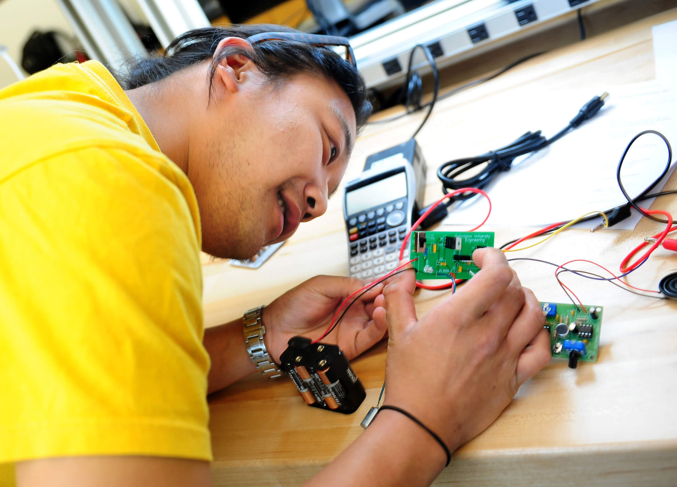 A student getting ready to present his final project during his circuits lab in the School of Engineering.