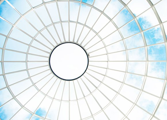 Looking up at the sky through a glass dome
