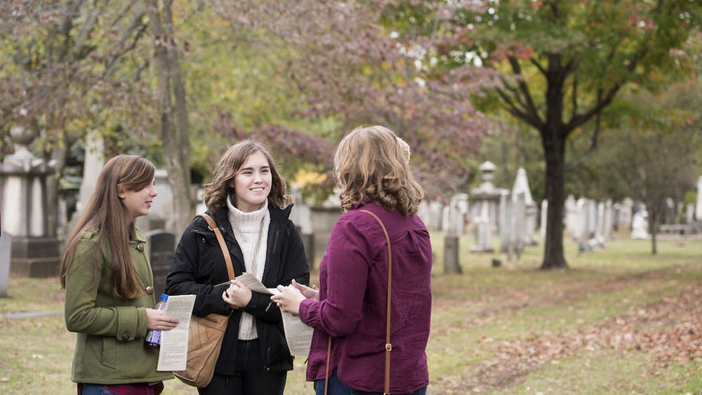 Quinnipiac University Honors students Jenna Sucato, a first-year student, English major in the MAT program, Emily Greene, a junior, engineering major, and Cassidy Healey, a junior, biomedical sciences major, from left, tour Grove Street Cemetery in New Haven as part of the honors program's New Haven trips