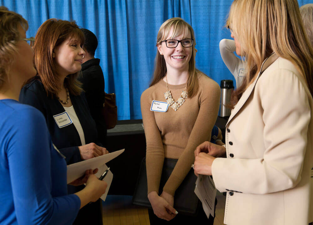 Quinnipiac University student Rachel Moon, center, talks with business women, Anne Graham, Linda Massaro and Michelle Sullivan, from left, during a speed networking session guided by motivational speaker Kathy McAfee