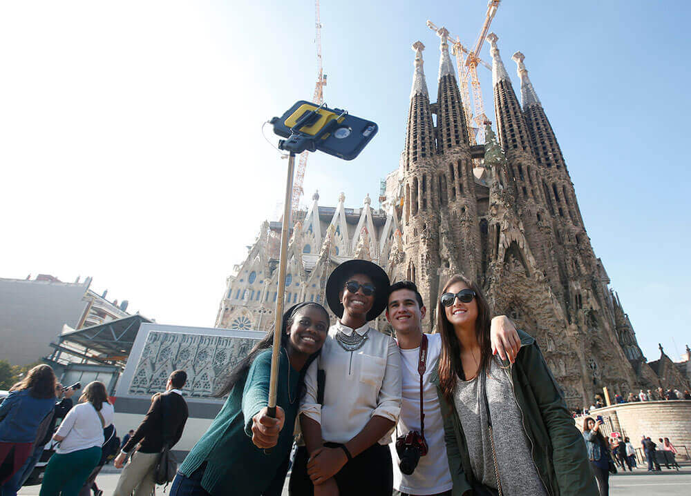 Quinnipiac students pose to take a selfie in front of the Basilica Sagrada Familia in Bareclona