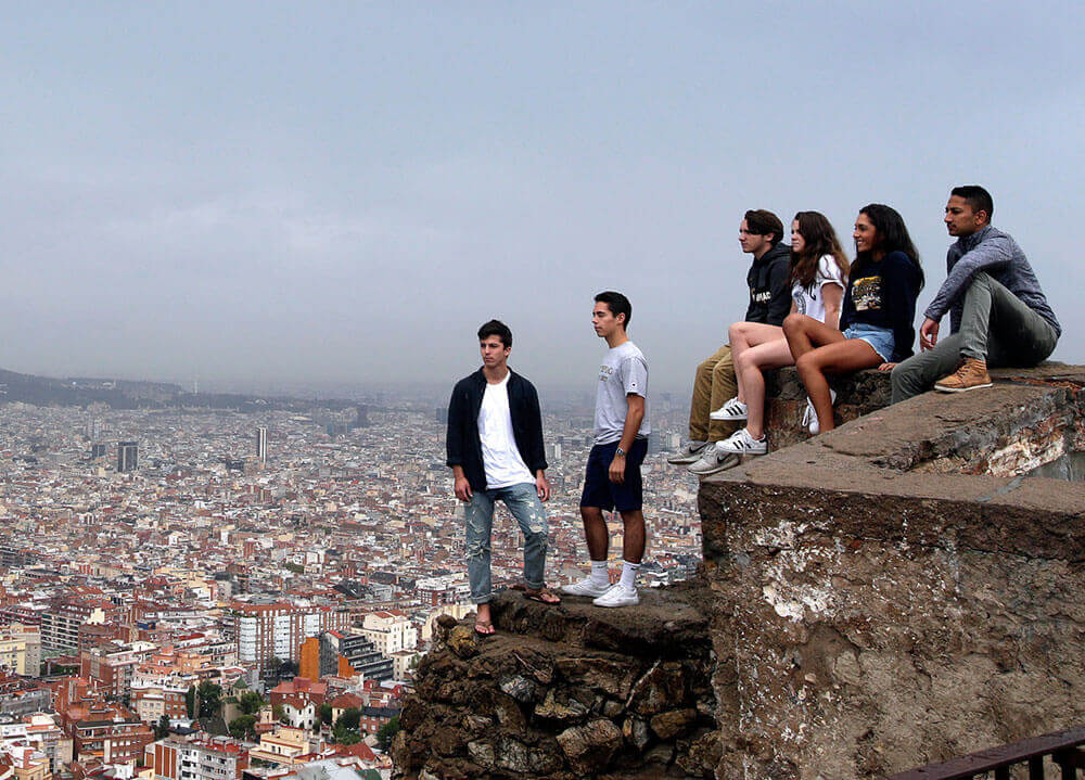 A group of Quinnipiac students look out over the city of Barcelona from a hilltop