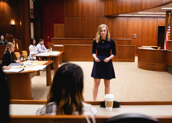 Quinnipiac student participates in a mock law trial at the School of Law Courthouse on the North Haven Campus.