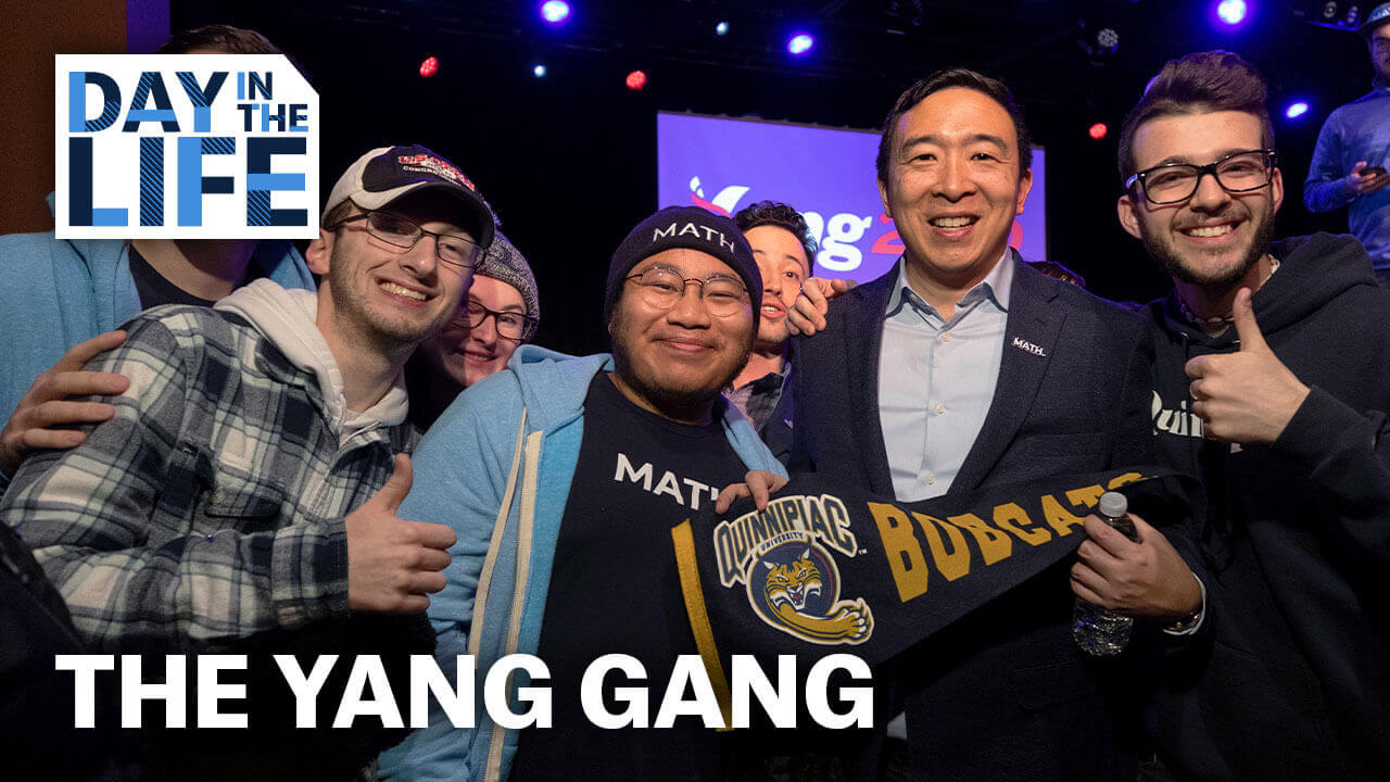 Students take a picture with presidential candidate Andrew Yang, starts video