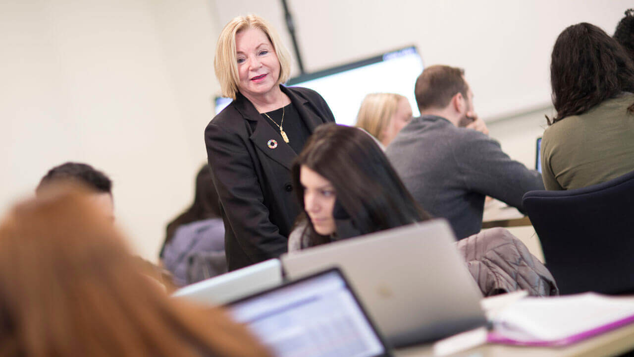 Assistant Teaching Professor of Entrepreneurship & Strategy Margaret Goralski, Ph.D., instructs students in the Center for Communications and Engineering