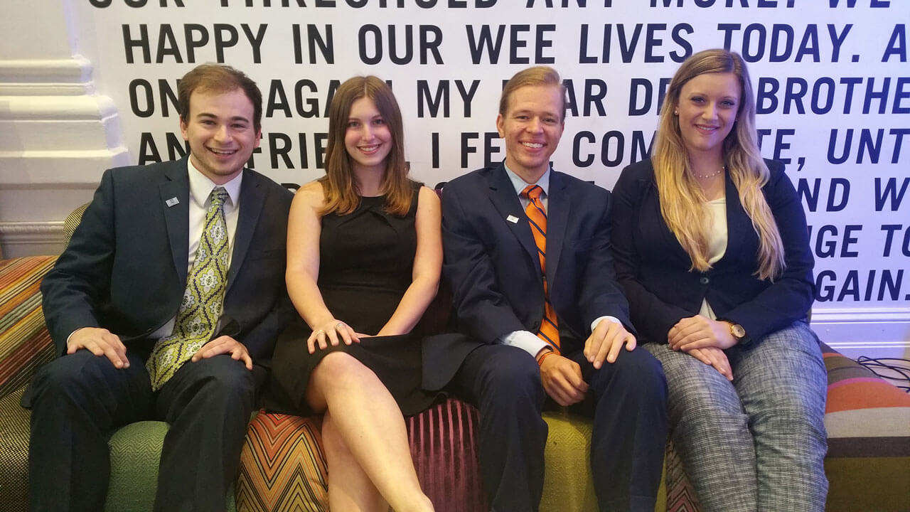 Four members of the Society for Human Resource Management sitting on a couch.