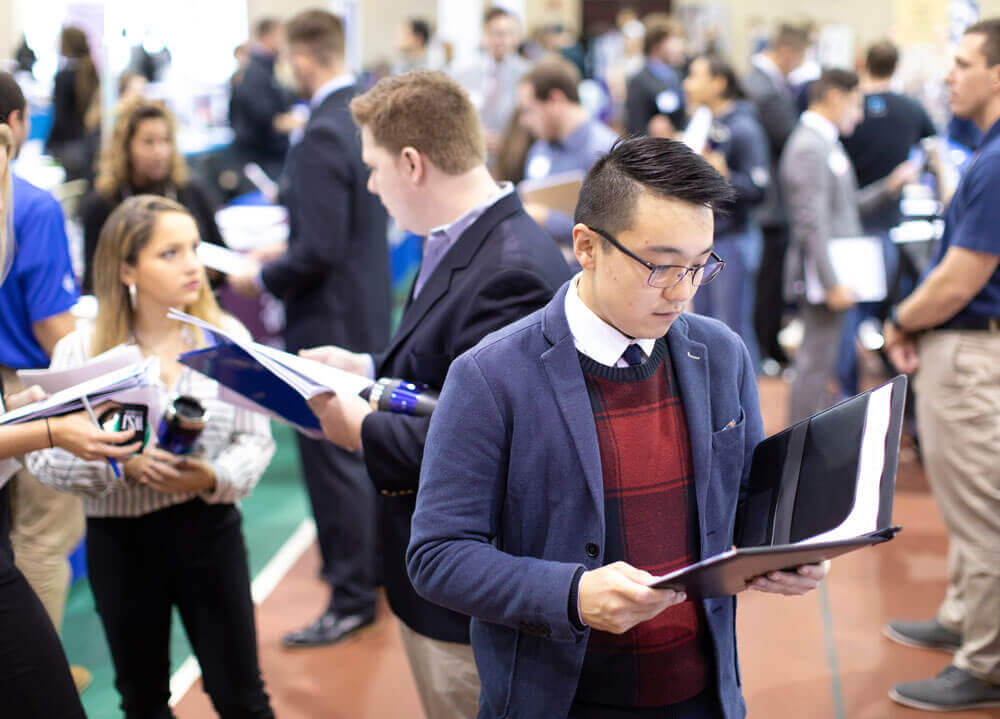A group of students attend a job fair