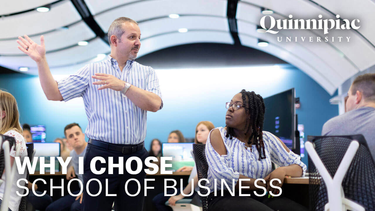 A business professor lectures in the Financial Technology Center, starts video