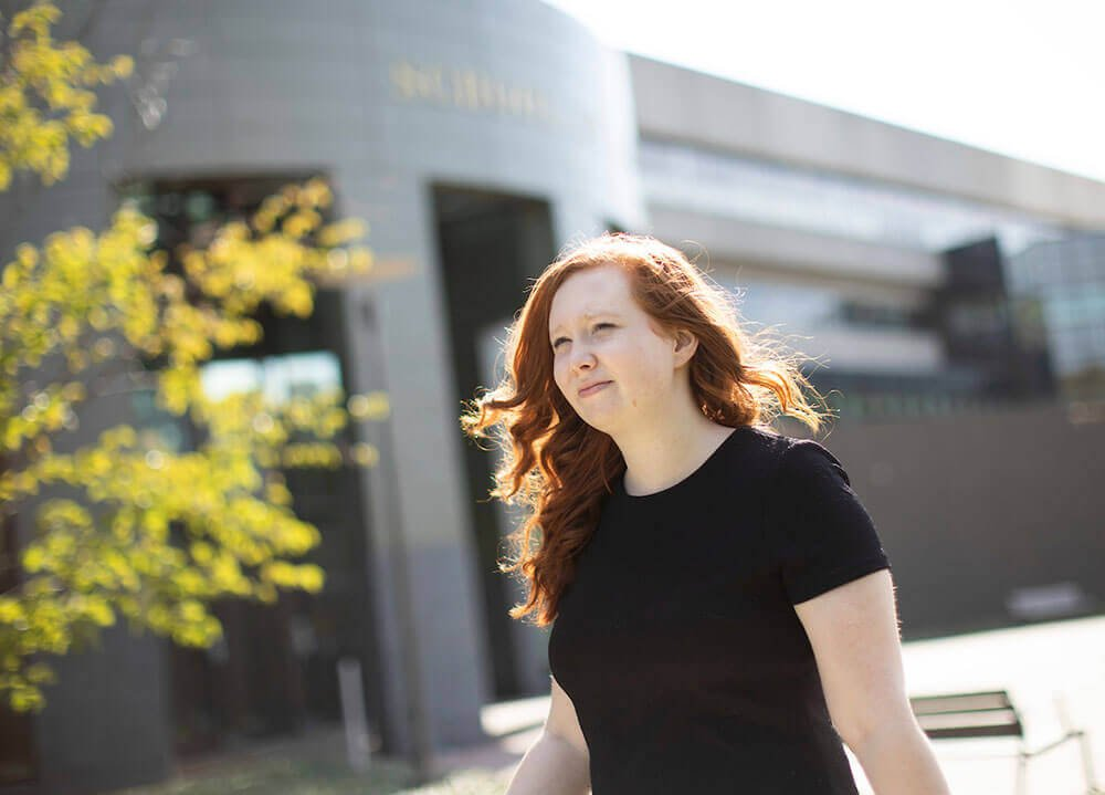 Law student Nicole Dwyer is pictured outside the main entrance of the School of Law Center