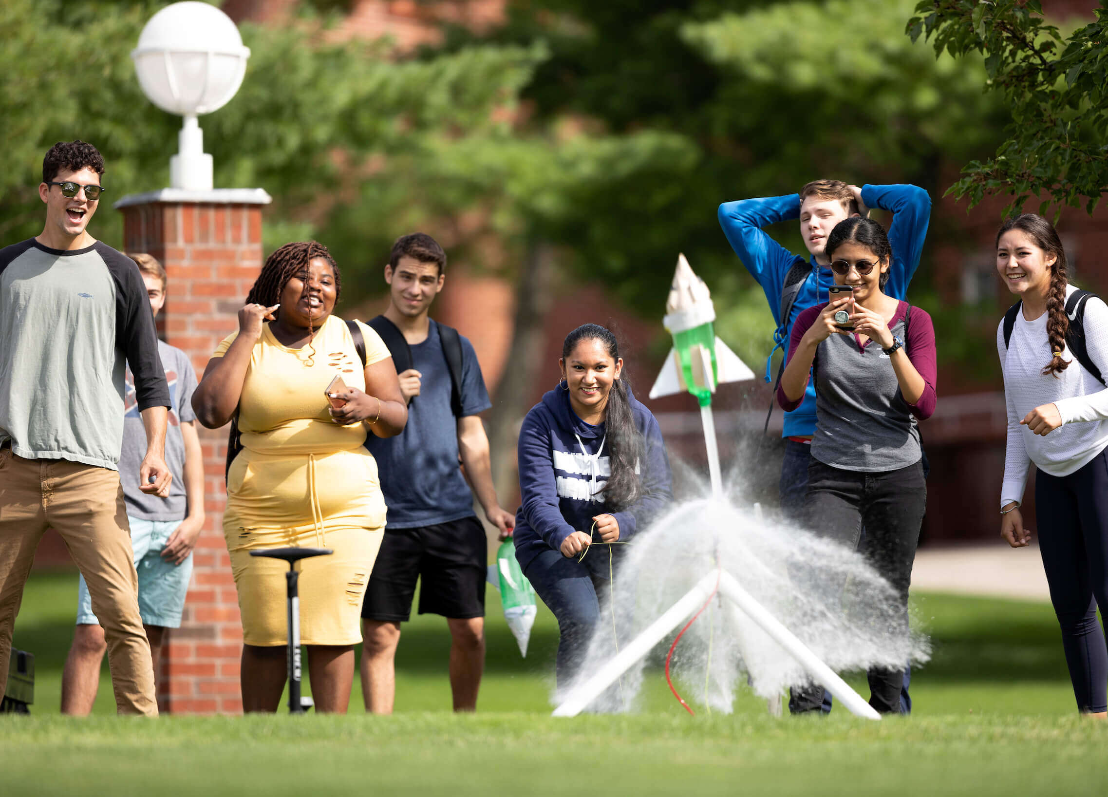 First-year engineering students launch water-bottle rockets into the air during class outside the Center for Communications and Engineering on Quinnipiac's Mount Carmel Campus