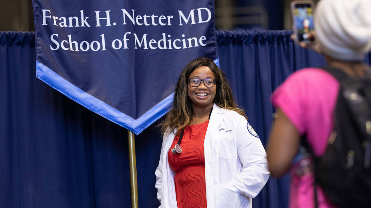 First-year medical student receiving her white coat.