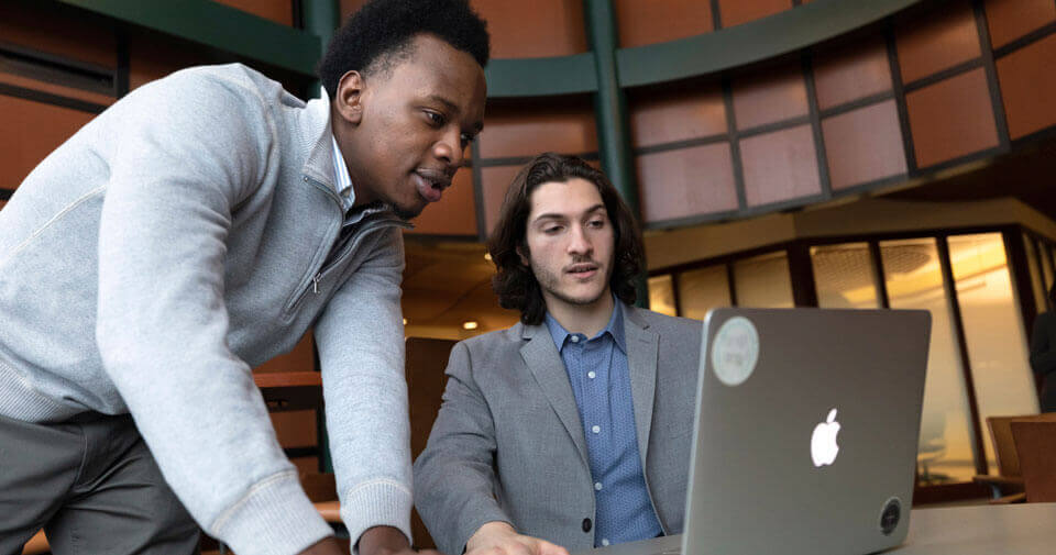 Two graduate students study on the Quinnipiac North Haven Campus