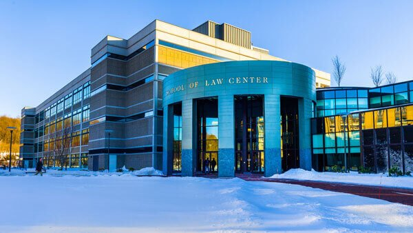 Outdoor view of the Quinnipiac School of Law Center on a bright winter day