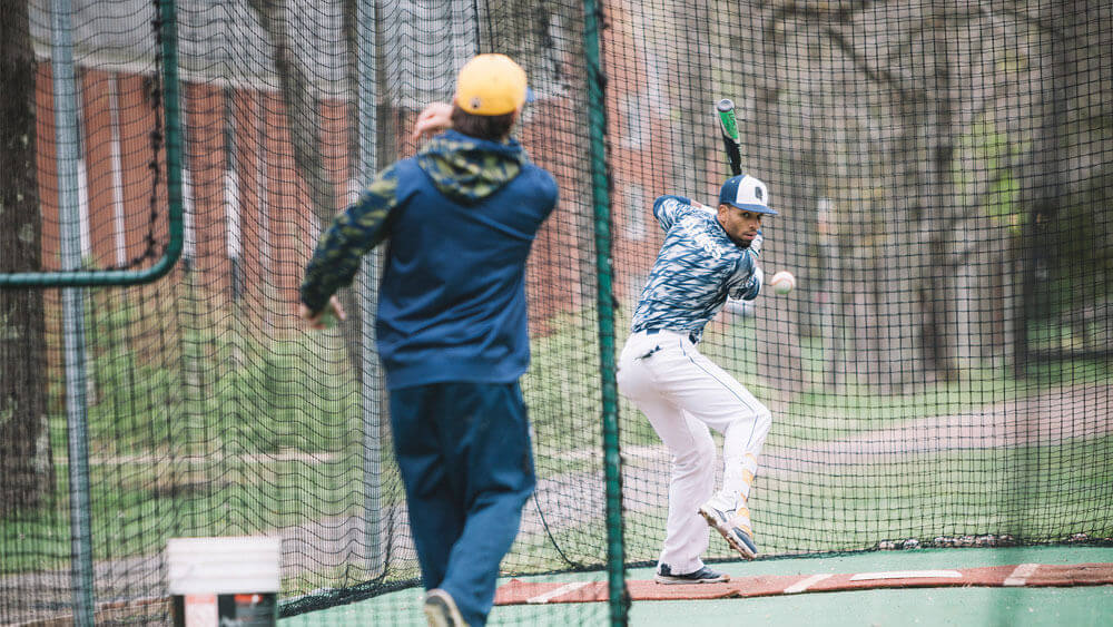 Practice makes perfect as a student-athlete takes a few swings on the Quinnipiac Baseball Field on the Mount Carmel Campus.