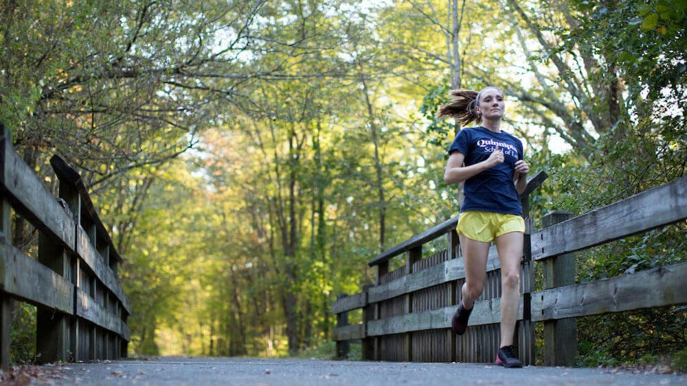 Shannon Haggerty, J.D. '21. runs on the Farmington Rail Trail near the Quinnipiac University campus.