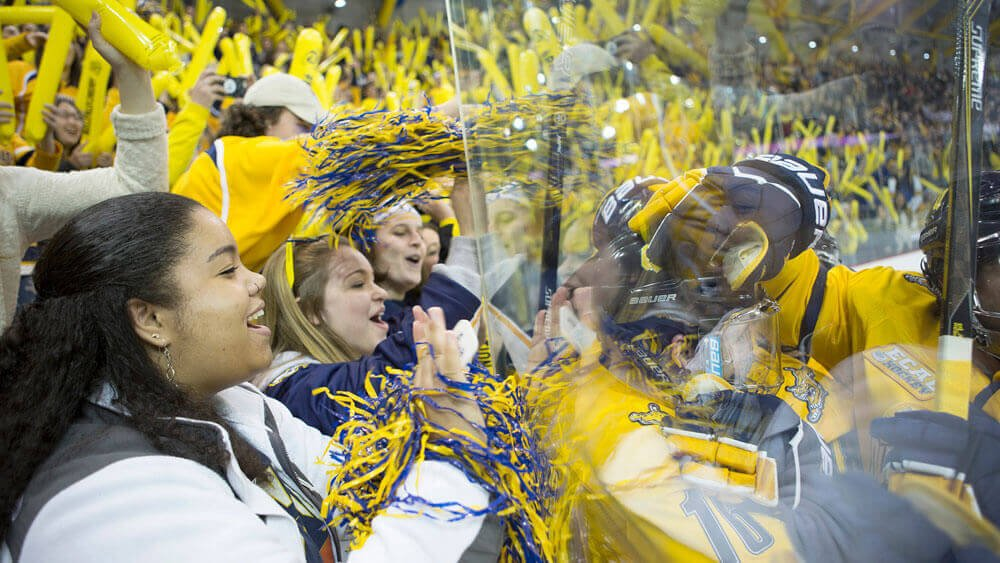 Members of #BobcatNation take a photo as they await the start of the men's hockey game against Yale at the People's United Center on the York Hill Campus.