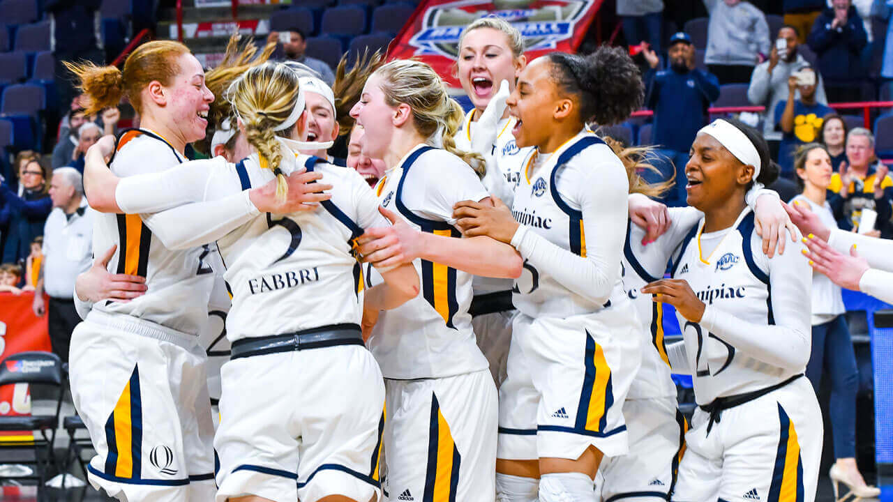 Students celebrate on court during the Women's Basketball MAAC Championship 2018