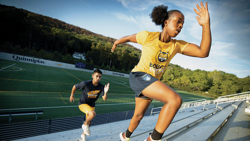 Students work out in the Quinnipiac Soccer Turf Complex