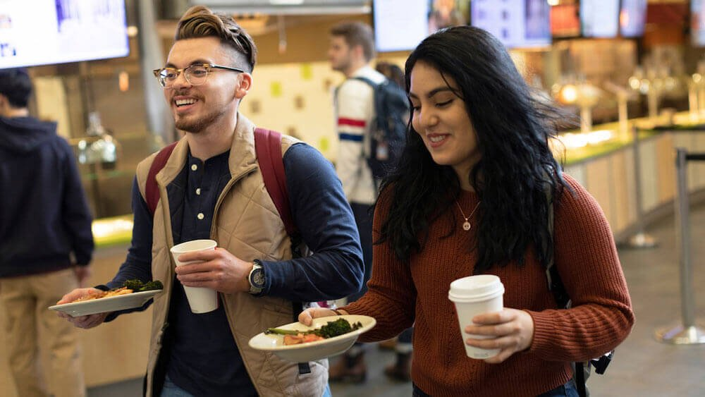 From left, orientation leaders Kyle Lopez '19, mechanical engineering, and Zurama Rodriguez '19, behavioral neuroscience, get lunch together in the dining hall of Quinnipiac University's Carl Hansen Student Center at the Mount Carmel Campus