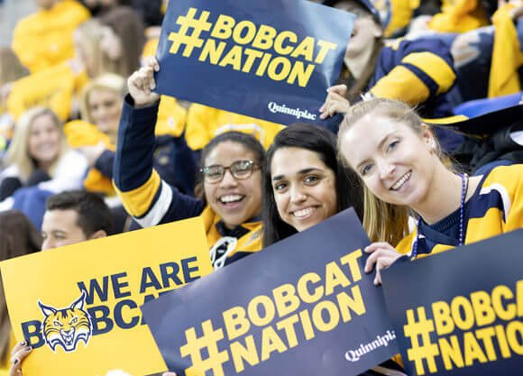 Quinnipiac fans cheer on their bobcats as mens ice hockey plays Yale in the 17th annual Heroes Hat hockey game, Friday, Feb. 8, 2019, at the People's United Center.