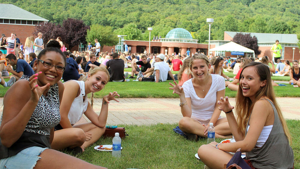 Students enjoy a  barbecue on the Mt Carmel campus.