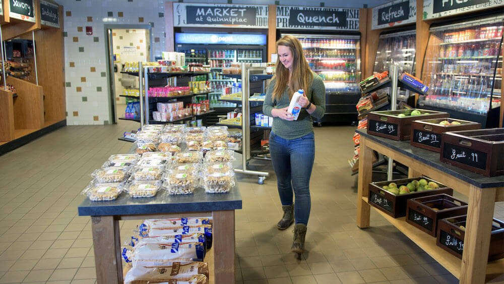 Quinnipiac senior Brenda Kittredge, a biomedical marketing major, shops in the market in the Rocky Top Student Center on Quinnipiac University's York Hill Campus