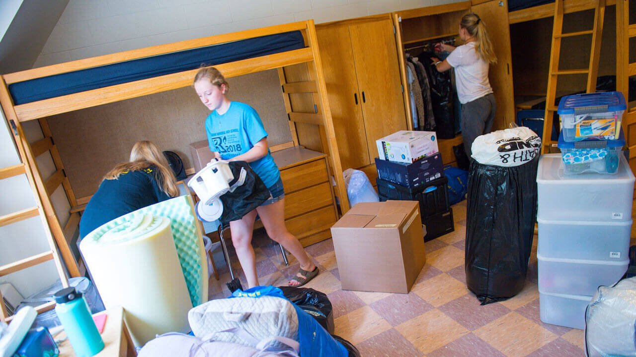 A student unpacking in their room