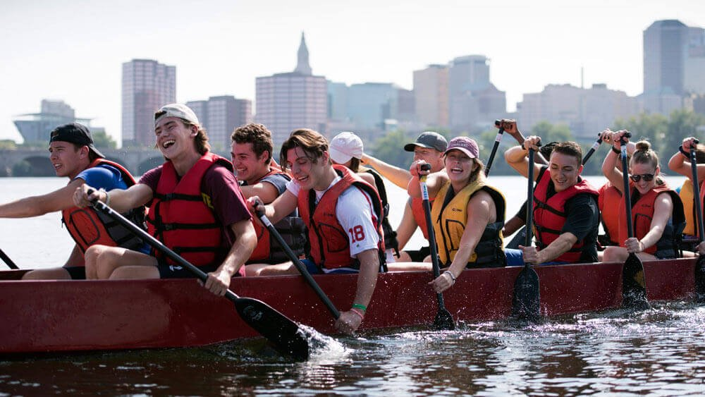 First-year students in the dual-degree BS/MBA (3+1) program in Quinnipiac's School of Business work together to row a dragon boat during a team building event Thursday, August 24, 2017 at Riverside Park in Hartford, Connecticut.