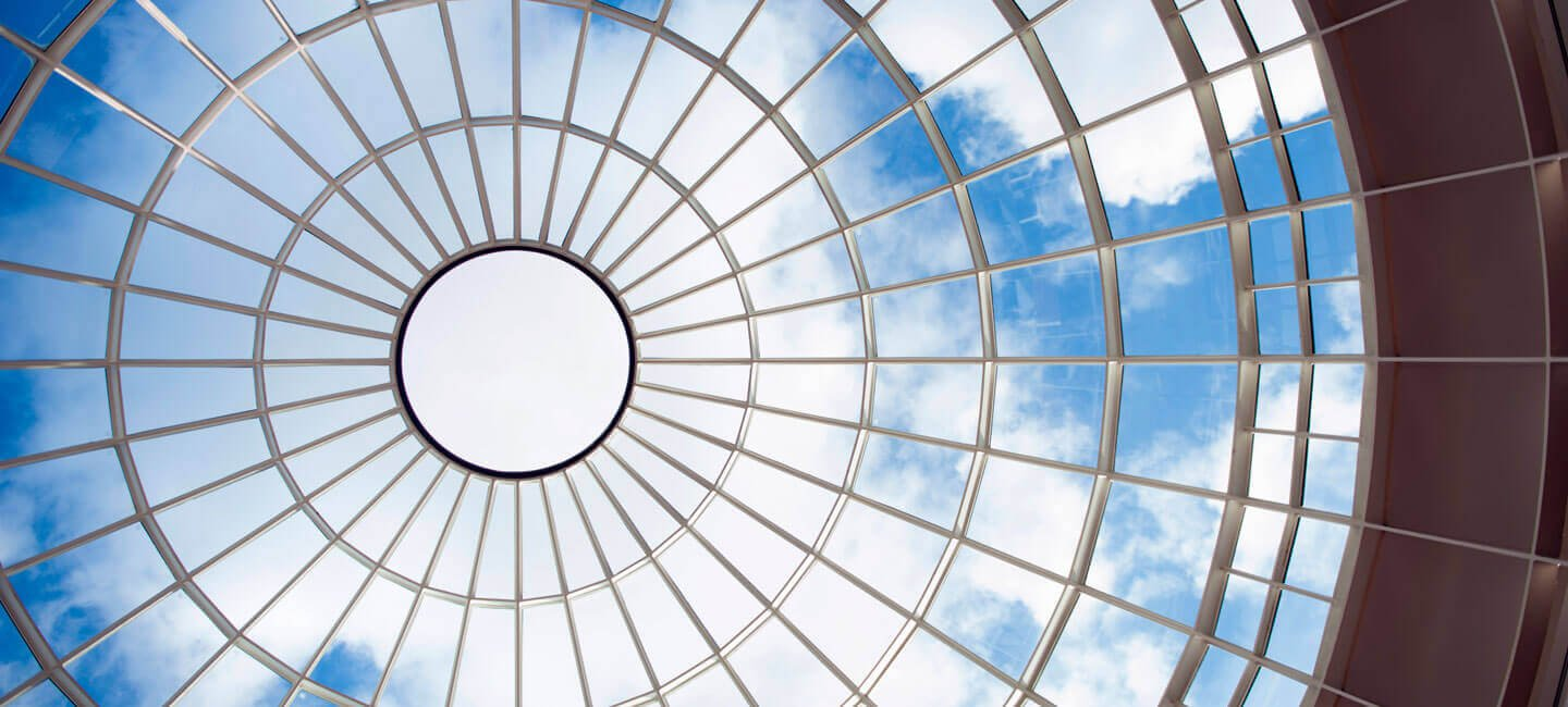 View of the sky through the Lender School of Business Center glass dome