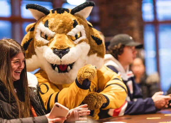Students celebrate the first night of On the Rocks, the new pub, with Boomer.