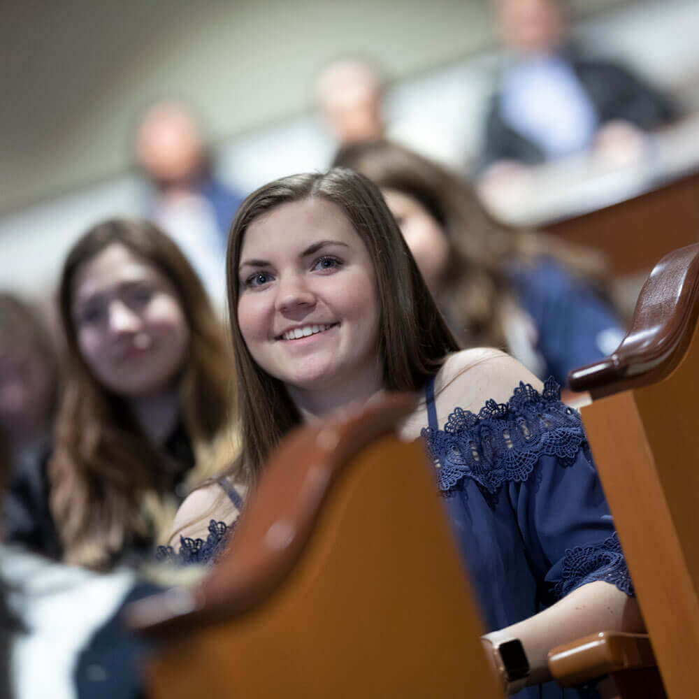 A prospective student listens during an information session