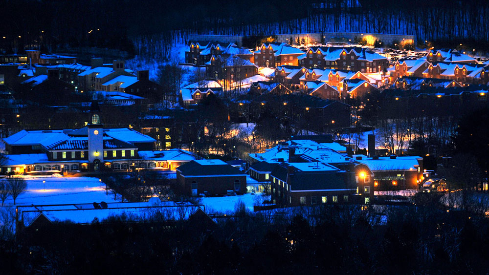 Aerial view of Mount Carmel Campus during a winter night