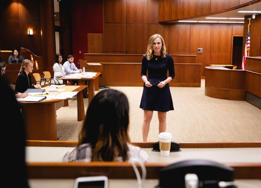 Caitlin Murphy in a mock courtroom, speaking to a mock jury