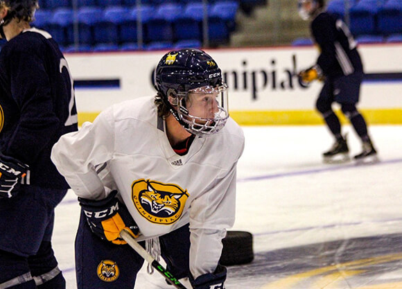 Skates on the ice in his Quinnipiac bobcats jersey